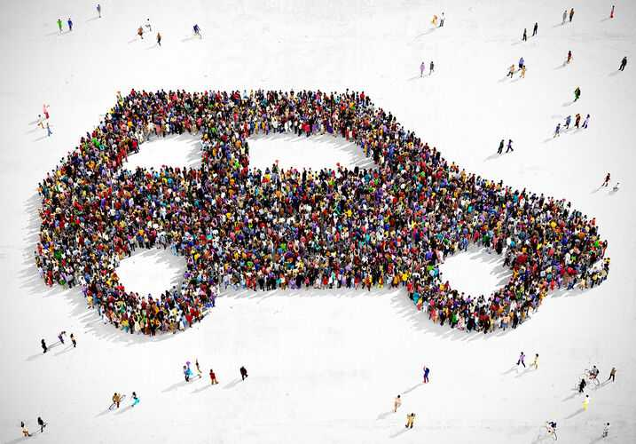 People forming shape of car