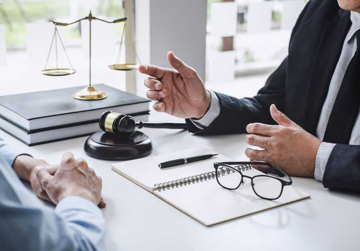 Lawyer talking to client