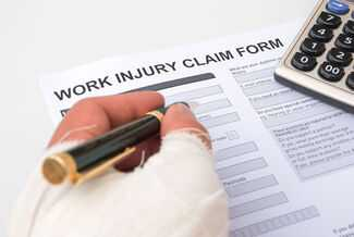 Person filling Work Injury Claim Form