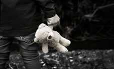 Person holding teddy bear