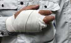 Man with injured hand